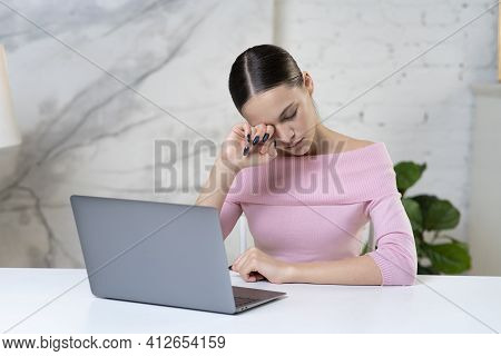 Tired Sleepy Girl, Young Unhappy Woman Is Rubbing, Massaging Her Eye After Long Working On Laptop Co