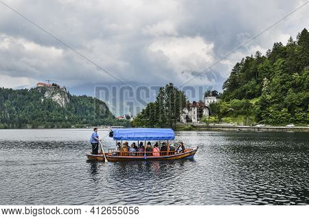 Bled, Slovenia - May 20, 2018: Beautiful Lake Bled In The Julian Alps And Old Wooden Boat. Mountains