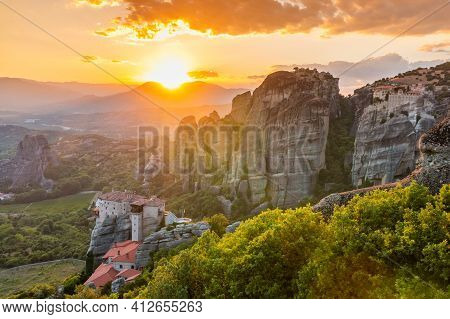 Meteora, Greece. Sandstone Rock Formations, The Rousanou And Nikolaos Monasteries At Sunset.