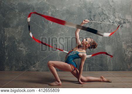 Young Girl Professional Gymnast Woman Dance Rhythmic Gymnastics With Ribbon At Studio