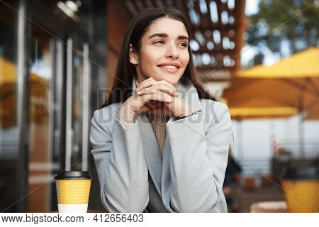 Portrait Of Beautiful Woman Drinking A Cup Of Tea In Cafeteria. Happy Businesswoman In A Cafe Drinki