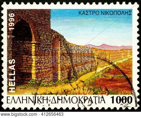 Moscow, Russia - March 15, 2021: Stamp Printed In Greece Shows Castle Of Nikopolis, Epirus, Greece,