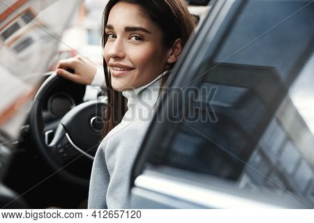 Close-up Of Elegant Businesswoman Open Car Door And Smiling At Camera. Female Entrepreneur Driving T