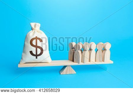 Group Of People And Dollar Money Bag On Weight Scales. Required Payment Of Staff Salaries. Staff Mai