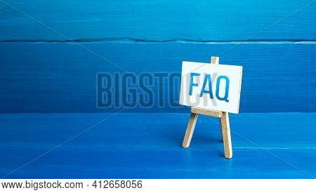 Easel With Faq (frequently Asked Questions). Available Answers To Overcome Difficulties And Misunder