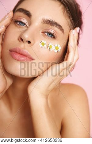 Romantic Girl With Natural Nude Makeup, Half-naked Body And Chamomile Blossoms On Cheek, Concept Of