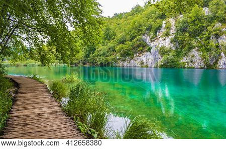Landscape Footbridge Over Turquoise Water. Plitvice Lakes National Park Croatia.