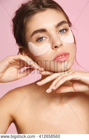 Sensual Woman With Naked Body And No Makeup, Natural Face, Using Under Eye Paches For Skin Nourishme