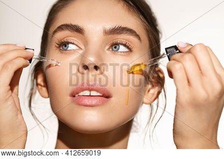 Beauty And Skin Care Concept. Face Of Woman Applying Tea Tree And Lemon Facial C-serum, Using Anti-a