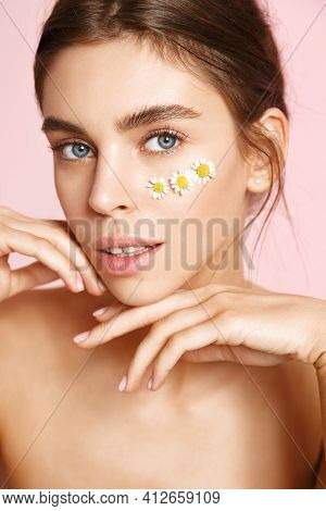 Beauty And Daily Care. Female Model With Chammomile As Under Eye Patches, Gently Touching Clean Nude
