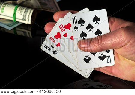 Poker Cards With Two Pairs Combination. Close Up Of A Gambler Hand Is Holding Playing Cards In Casin