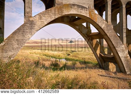 Historic Rosalia Railroad Bridge Arch. The Palouse Valley through an arch in the Rosalia railroad bridge. Washington State, USA.