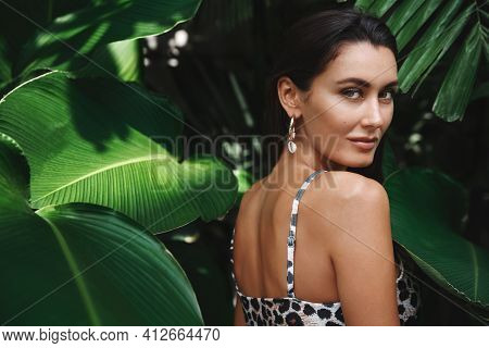 Tropical Vacation And Travelling Concept. Sexy Brunette Woman In Bikini Standing In Jungle Nature, T