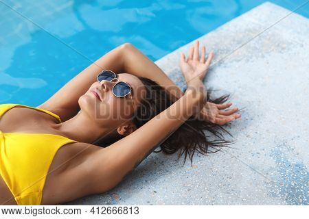 Cropped Close-up Of Sexy Woman In Bikini, Lying Down Swimming Pool Edge, Sunbathing At Hotel Pool Ar
