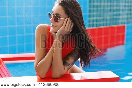 Attractive Woman In Red Bikini And Sunglasses, Turn Away, Contemplate Carribean Panorama. Sexy Femal