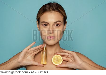 Model Using Natural Cosmetic Product For Hydrated, Glowing And Healthy Facial Derma. Essential Oil F
