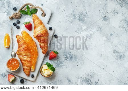 Fresh Sweet Croissants With Butter And Orange Jam For Breakfast. Continental Breakfast On A White Co