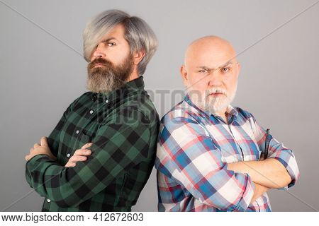 Generation Concept. Old Father And Son. Older Younger Generations. Two Serious Mens