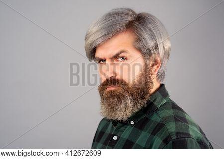 Barbershop Procedures. Handsome Bearded Man Portrait. Mustache And Trendy Hairdo