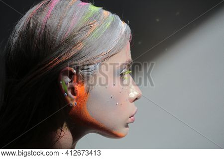Abstract Fashion. Colourful Make-up. Art Makeup. Beauty Woman With Bright Make-up. Vogue Style Face.