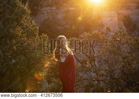 Carefree Freedom Concept. Carefree Woman At Cliff. Successful Life