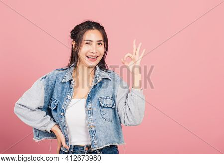 Portrait Asian Beautiful Young Woman Standing, She Made Finger Ok Symbol Sign To Agree Side Away Loo