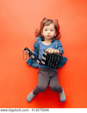 Funny Cute Child Actor Holding Cinema Clapper