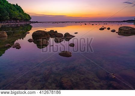 Long Exposure Image Of Dramatic Sky Seascape With Rock In Sunset Scenery Background.beautiful Sunris
