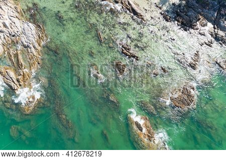 Sea Aerial View Top View Of Amazing Nature Background.beautiful Waves Crashing On The Rocky Shore Is
