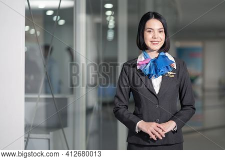 Portrait Of Beautiful Caucasian Flight Attendant Staff Smiling And Looking At Camera With Confidence