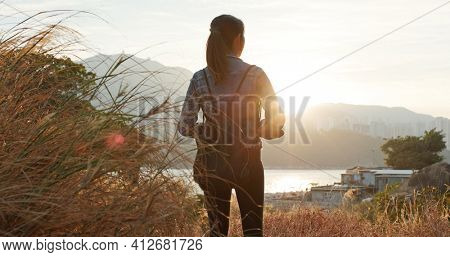Woman enjoy the sunset view at nature landscape
