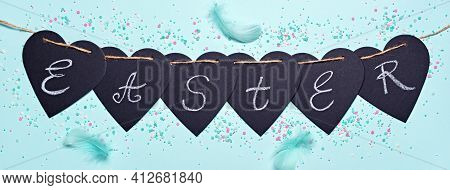 Happy Easter Banner. Garland With Easter Word, Feathers And Sugar Sprinkles On Blue Background. Flat
