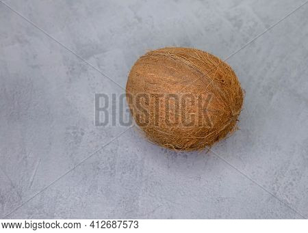 Imperfect Coconut. High Angle View Of Coconut Against Gray Background. Selective Focus Of Fresh Tast