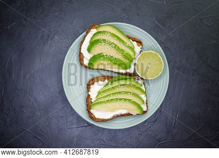 Wholesome Food On A Plate On The Kitchen Table. Toasted Cereal Bread Toast. Useful Diet Food. Sliced