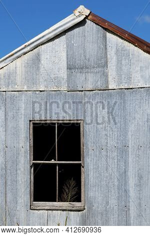 A Tumble Down Old Tin Shack In The Country