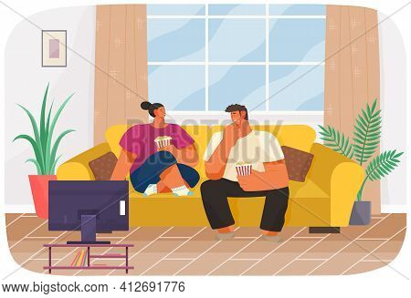 Couple Sitting On Sofa, Watching Movie And Eating Popcorn Together. People Are Relaxing Together