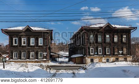 Tomsk, Russia - March 12, 2021. Wooden Residential Buildings On The Street Of The Old District Of To