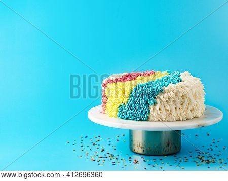 Shag Cake On Blue Background. Colorful Vanilla Shag Cake With Perfect Vanilla Buttercream. Idea Of V
