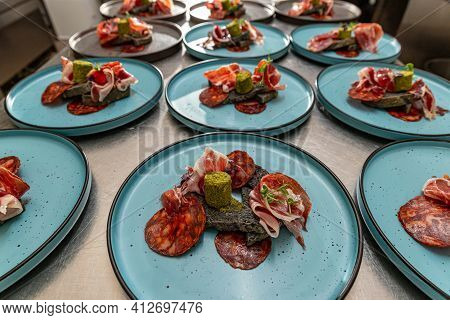 Plate With Spanish Serrano Ham Served With Black Coal Bread And Seasoned Butter, Fine Dining