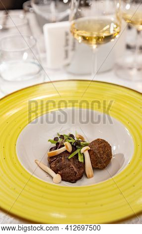 Matzo Balls With Crunchy Pea Pods, Cut In Julienne Decorated With Mushrooms Waiting To Be Served