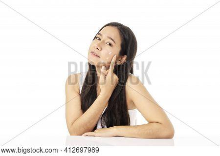 Woman Applying Skin Care Cream