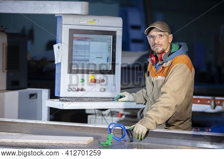A Furniture Production Worker Behind A Programmed Machine Makes Furniture Parts. Furniture Manufactu