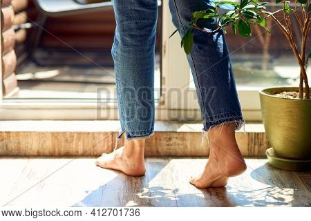 Bare Feet Of Woman Going Out On Terrace