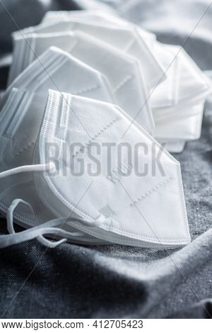 KN95 face mask. FFP2 mask as covid-19 protection. Coronavirus  protection mask on tablecloth.