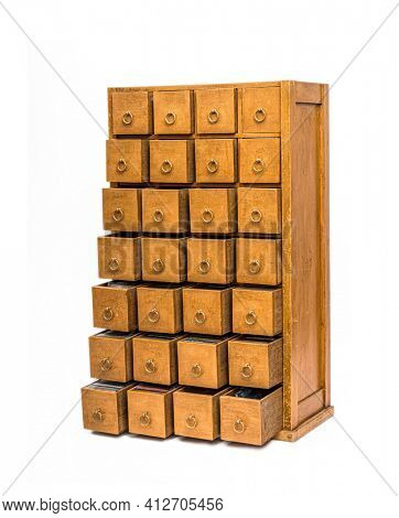 Ancient wooden chest with opend drawers isolated