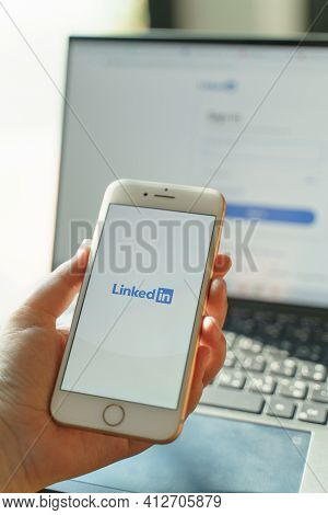 Chiang Mai, Thailand - Feb. 05,2021: Woman Holds Iphone With Linkedin Application On The Screen And