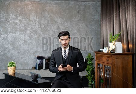Business Man In A Suit Using Smartphone Deal A Customer And Manage Order. Entrepreneur Startup Busin