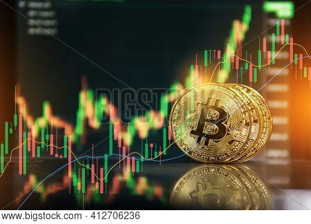 Gold Bitcoin With Growth Graph Chart Trading View. Bitcoin Gold Coin And Defocused Chart Background.