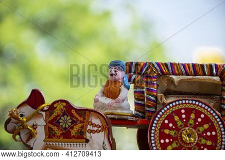 Stock Photo Of A Beautiful Traditional Indian Wooden Bull Cart And Statue Of Farmer Sitting On Bull