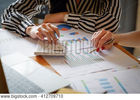 Close Up Of Businesswoman Working On Calculator To Calculate Business Data The Financial Report In M